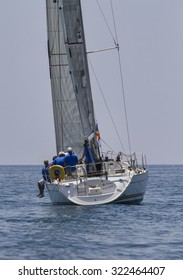 Italy, Sicily, Mediterranean Sea; 30 june 2012, people cruising on a sailboat during a race - EDITORIAL