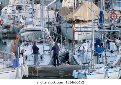 Italy, Sicily, Mediterranean sea, Marina di Ragusa; 16 February 2019, people and luxury yachts in the port - EDITORIAL