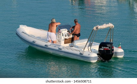 Italy, Sicily, Mediterranean Sea, Marina di Ragusa (Ragusa Province); 20 July 2019, people on a rubber boat in the port - EDITORIAL