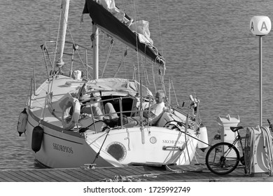 Italy, Sicily, Mediterranean Sea, Marina di Ragusa (Ragusa Province); 8 May 2020, people on a sailing boat in the port - EDITORIAL