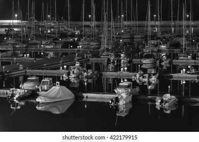 Italy, Sicily, Mediterranean sea, Marina di Ragusa; 18 May 2016, boats and luxury yachts in the port at night - EDITORIAL