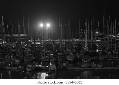 Italy, Sicily, Mediterranean sea, Marina di Ragusa; 13 December 2016, boats and luxury yachts in the port at night - EDITORIAL