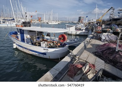 Italy, Sicily, Mediterranean sea, Marina di Ragusa; 22 December 2016, fishing nets, fishing boats and luxury yachts in the port - EDITORIAL