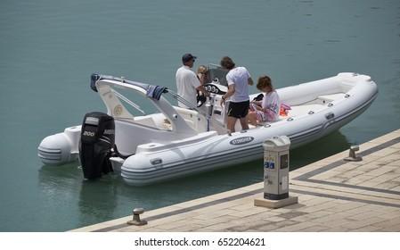 Italy, Sicily, Mediterranean Sea, Marina di Ragusa (Ragusa Province); 2 June 2017, people on a big rubber boat in the port - EDITORIAL