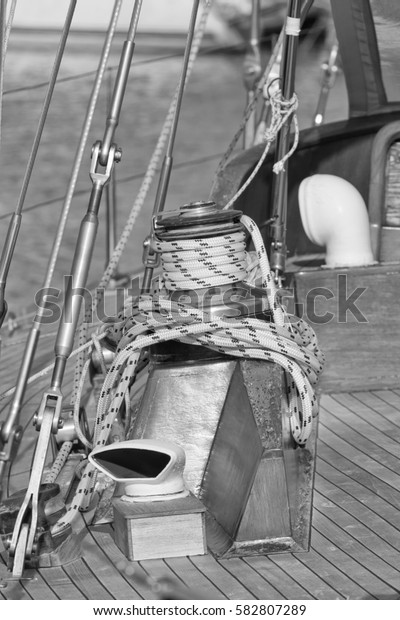 Italy, Sicily, Mediterranean Sea, sailing boat in the port, winch and nautical ropes