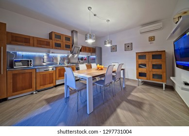 Italy, Sicily, Modica (Ragusa Province); 30 April 2018, apartment kitchen and dining table - EDITORIAL