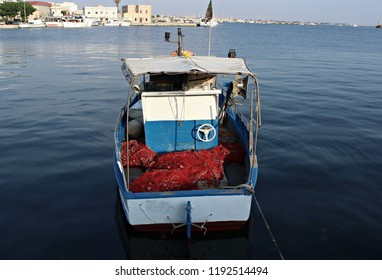 Italy, Sicily: Old small boat in Marsala harbour.