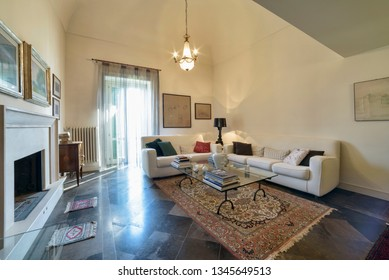 Italy, Sicily, Ragusa; 14 April 2015, elegant private house, living room with fireplace - EDITORIAL