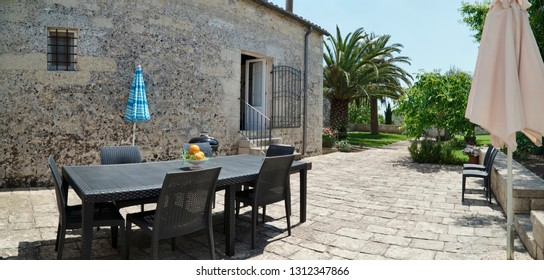 Italy, Sicily, Ragusa Province, countryside; 11 May 2018, elegant private farm house, view of the patio of the backyard garden - EDITORIAL