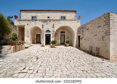Italy, Sicily, Ragusa Province, countryside; 28 May 2018, private stone farm house, view of the patio and the facade - EDITORIAL