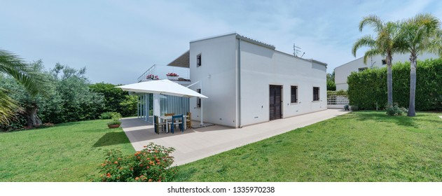Italy, Sicily, Ragusa Province, countryside; 4 June 2018, elegant private house, view of the facade and the garden - EDITORIAL