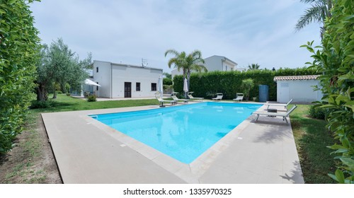 Italy, Sicily, Ragusa Province, countryside; 4 June 2018, elegant private house, view of the facade and the garden with the swimming pool - EDITORIAL