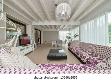 Italy, Sicily, Ragusa Province, countryside; 4 June 2018, elegant private house, living room with dining table - EDITORIAL