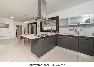 Italy, Sicily, Ragusa Province, countryside; 4 June 2018, elegant private house, living room, view of the kitchen - EDITORIAL