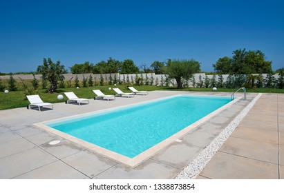 Italy, Sicily, Ragusa Province, countryside; 26 May 2018, elegant private house, view of the swimming pool and the garden - EDITORIAL