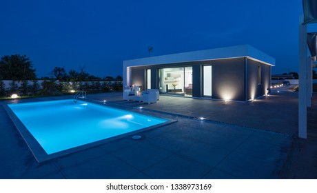 Italy, Sicily, Ragusa Province, countryside; 26 May 2018, elegant private house, view of the facade, the swimming pool and the garden at sunset - EDITORIAL