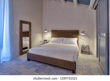 Italy, Sicily, Ragusa Province, countryside; 1 August 2015, elegant private house, bedroom - EDITORIAL