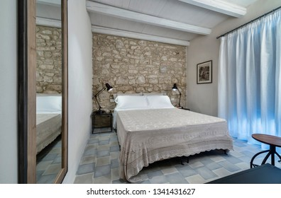Italy, Sicily, Ragusa Province, countryside; 2 August 2015, elegant private house, bedroom - EDITORIAL