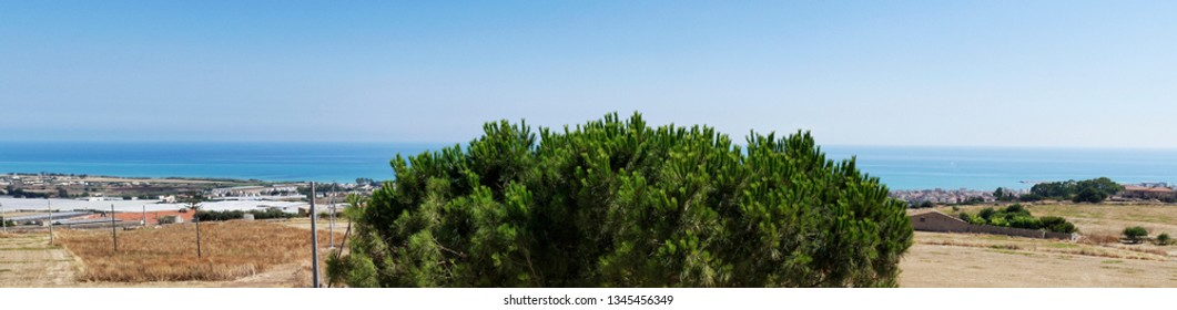 Italy, Sicily, Ragusa Province, countryside, panoramic view of the Sicilian Southern East coast and the Mediterranean Sea.
