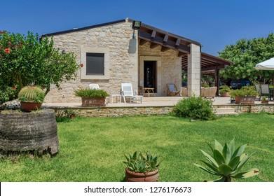 Italy, Sicily, Sampieri (Ragusa Province), countryside; 10 August 2018, stone house patio and garden - EDITORIAL
