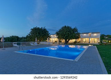 Italy, Sicily, Santacroce Camerina (Ragusa Province), countryside; 8 May 2018, house garden and swimming pool at sunset - EDITORIAL