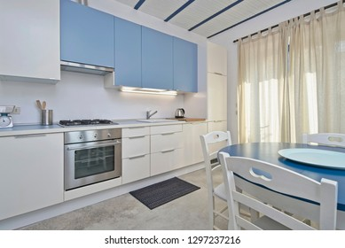 Italy, Sicily, Scicli (Ragusa Province); 20 April 2018, apartment kitchen and dining table - EDITORIAL