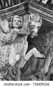 Italy, Sicily, Scicli (Ragusa province), the Unesco Baroque Fava Palace facade (18th Century a.C.), statues under a balcony