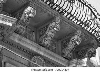 Italy, Sicily, Scicli (Ragusa province), the Unesco Baroque Spadaro Palace facade (18th Century a.C.),  ornamental statues under a balcony