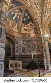 Italy, Siena - December 26 2016: the interior view of San Giovanni Baptistery in Siena, frescoes on walls and ceiling on December 26 2016 in Siena, Tuscany, Italy.