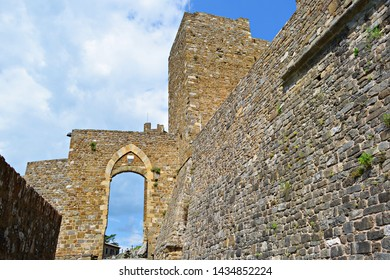 Italy, Siena, Montalcino, June 2019 ancient medieval gate of the defensive walls of the fortress of Montalcino in Tuscany. The town is known for the production of the famous Brunello wine
