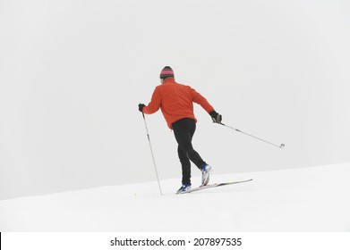 Italy, South Tyrol, man cross-country skiing, rear view