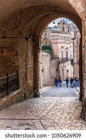 Italy, Southern Italy, Region of Basilicata, Province of Matera, Matera. Small cobblestone streets and arched paths. Sightseeing group.  November 27, 2016