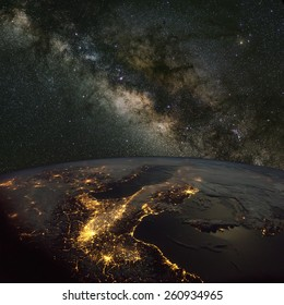Italy from space at night with the Milky Way above. Elements of this image furnished by NASA.