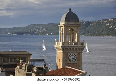 Italy, Trieste, harbor, church tower and sailing-boats.