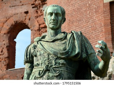 Italy /Turin – August 11, 2020: the statue of Julius Caesar in front of the Porta Palatina which was the Porta Principalis Dextera of Augusta Taurinorum, or the Roman civitas now known as Turin.