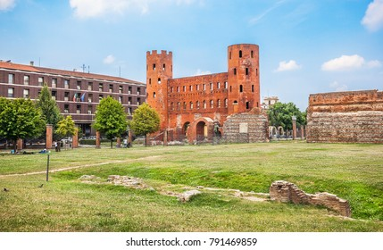 Italy, Turin - july 08, 2016: View of Palatine Towers, remains of the old Roman wall in Turin, Italy.