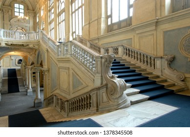 Italy / Turin – May 16, 2018: Palazzo Madama is the work of the architect Filippo Juvarra. The interior is divided into an immense atrium where the majestic double ramps of the grand staircase wind.