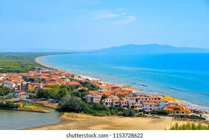 Italy, Tuscany, Castiglione della Pescaia, Maremma Tuscany, Panoramic view of the coast, beach and sea, from the castle overlooking the new village