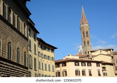 Italy, Tuscany / Florence – October 27, 2014: The beautiful San Firenze square in Florence with the palaces of the Renaissance, the bell tower of the Florentine Badia.