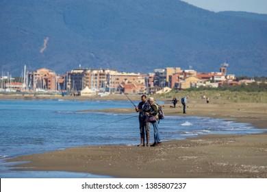 Italy Tuscany Maremma, on the beach towards Bocca di Ombrone, view of the coast line, in the background Marina di Grosseto and Castiglione della Pescaia
