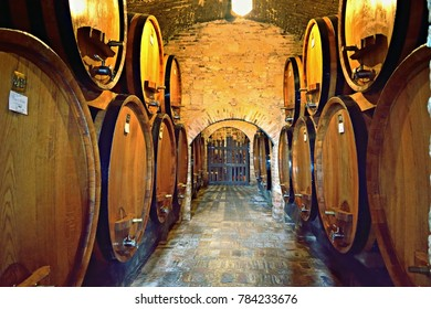 Italy, Tuscany, Montepulciano, August 2017 underground of a wine cellar with oak barrels containing the famous Nobile di Montepulciano red wine