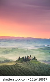 Italy, Tuscany, San Quirico d'Orcia - May, 19, 2017. A farmhouse near Pienza and San Quirico d'Orcia during springtime in Tuscany qhen the wheat is ready for harvest.