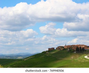 Italy, Tuscany: Village under the clouds.