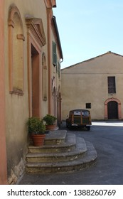 Italy, Tuscany: Vintage car in Trequanda Square.