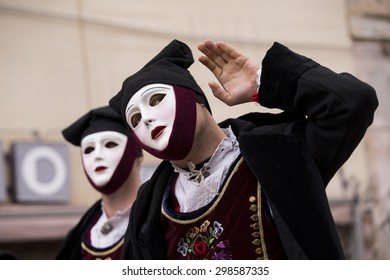 ITALY - Two masked horsemen participate to the traditional race to the star of Sa Sartiglia, the carnival of the city Oristano in Sardinia on February 15, 2015