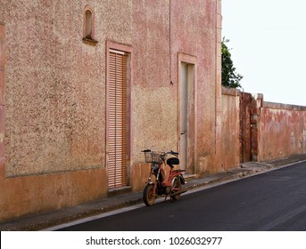 Italy: Typical Salento house with old motorcycle.