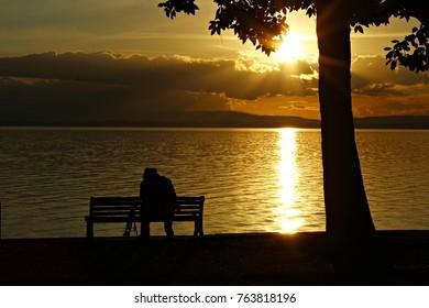 Italy, Umbria: Photografer silhouette in Trasimeno sunset.