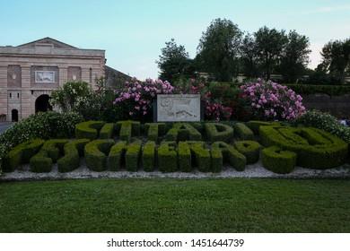 ITALY, VENETO, PROVINCE VERONA, PESCHIERA DEL GARDA: Verona Gate, Porta Verona. Decorative lettering from boxwood: city of peschiera (citta di Peschiera) Alessandro Bazzoffia architect