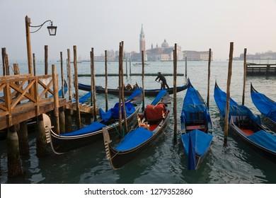 Italy, Veneto, Venice, view of Gondolas from Piazza San Marco, with San Giorgio Maggiore in the background