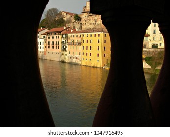 Italy, Veneto: View of the houses on the river through the railing of the Old Bridge to Bassano del Grappa.